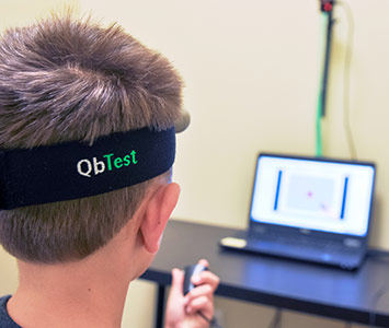 young boy taking QbTest for ADHD at Greenville ADHD Specialists office